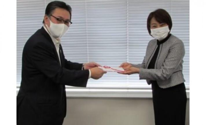 回胴遊商、アクロスジャパンに寄付金を贈呈